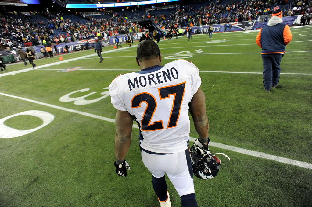 . Denver Broncos running back Knowshon Moreno (27) walks off the field dejected after their loss to the New England Patriots 34-31 in overtime November 24, 2013 at Gillette Stadium. (Photo by John Leyba/The Denver Post)