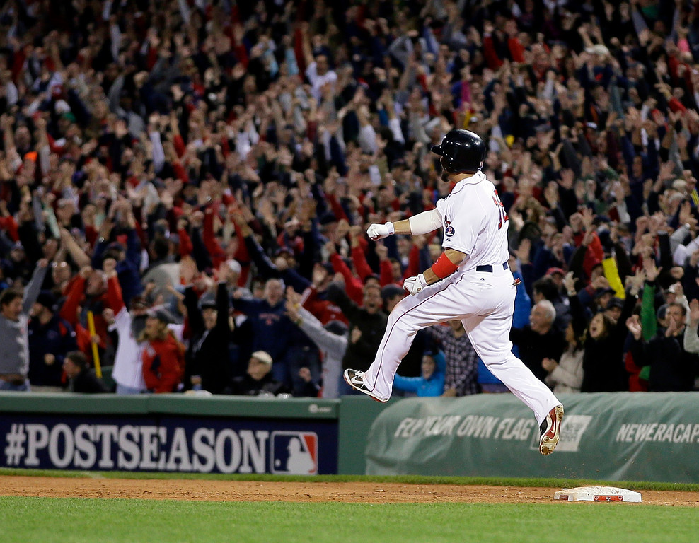 . Boston Red Sox\'s Shane Victorino celebrates his grand slam against the Detroit Tigers as he rounds first base in the seventh inning during Game 6 of the American League baseball championship series on Saturday, Oct. 19, 2013, in Boston. (AP Photo/Matt Slocum)