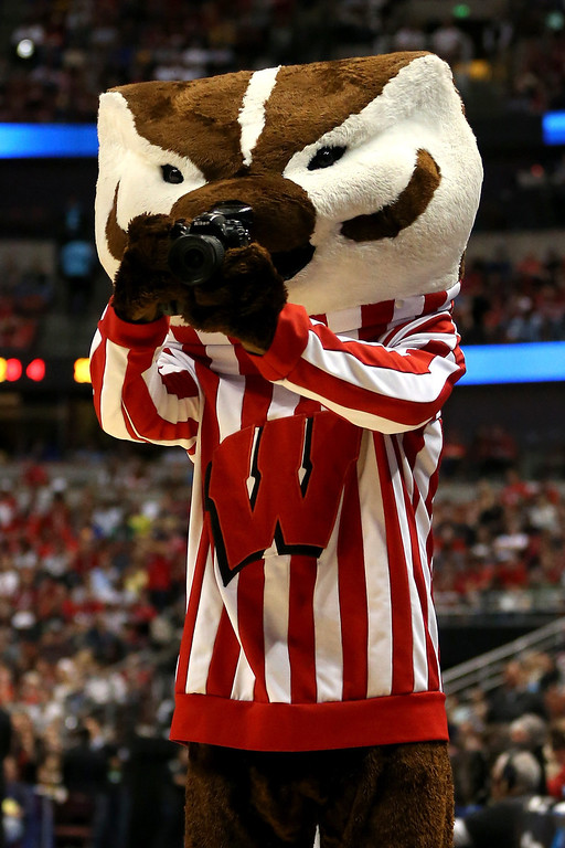 . The Wisconsin Badgers mascot Bucky uses a camera to take a picture in the first half while the Badgers take on the Arizona Wildcats during the West Regional Final of the 2014 NCAA Men\'s Basketball Tournament at the Honda Center on March 29, 2014 in Anaheim, California.  (Photo by Jeff Gross/Getty Images)