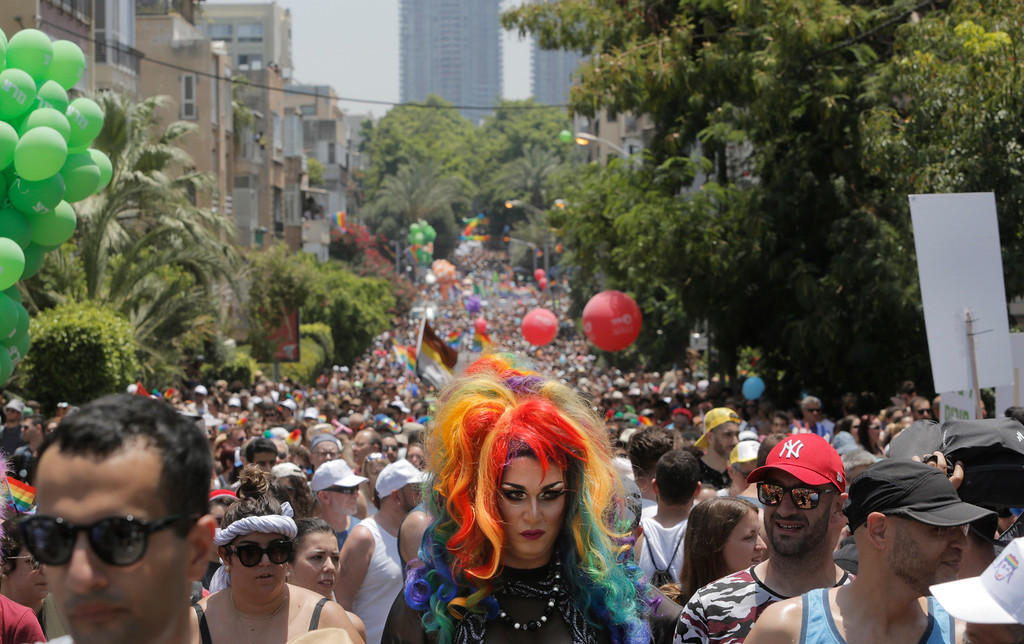 . Israelis and tourists participate in the gay pride parade in Tel Aviv, Israel, Friday, June 8, 2018. (AP Photo/Sebastian Scheiner)