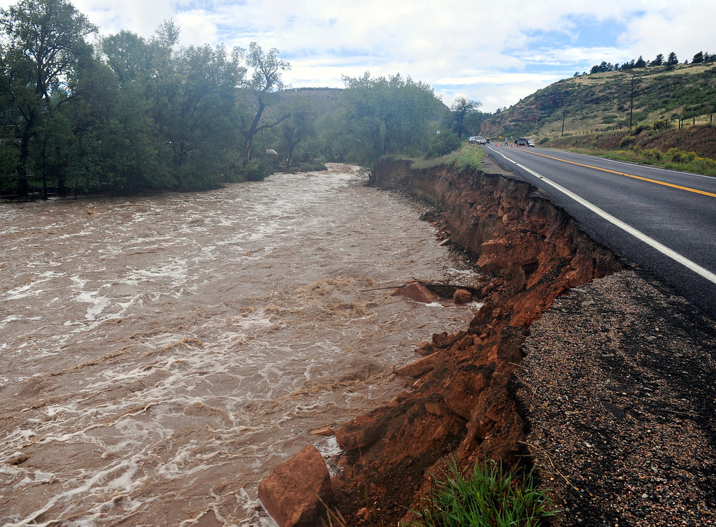 . Flood waters erode an area near Colo. Highway 7 outside Lyons Friday, Sept. 13, 2013. (Greg Lindstrom/Times-Call)