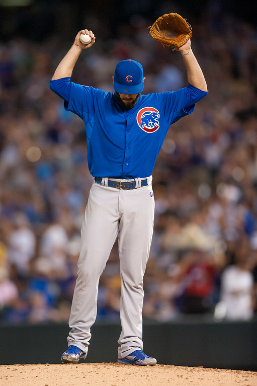 . DENVER, CO - AUGUST 06:  Jake Arrieta #49 of the Chicago Cubs reacts after giving up a sixth inning home run against the Colorado Rockies at Coors Field on August 6, 2014 in Denver, Colorado.  (Photo by Dustin Bradford/Getty Images)