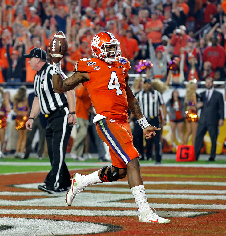 . Clemson quarterback Deshaun Watson (4) runs in for a touchdown against Ohio State during the second half of the Fiesta Bowl NCAA college football game, Saturday, Dec. 31, 2016, in Glendale, Ariz. (AP Photo/Ross D. Franklin)