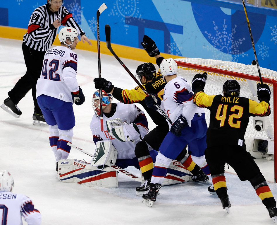 . Patrick Hager (50), of Germany, celebrates after scoring a goal during the second period of the preliminary round of the men\'s hockey game at the 2018 Winter Olympics in Gangneung, South Korea, Sunday, Feb. 18, 2018. (AP Photo/Matt Slocum)