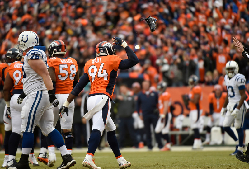. DeMarcus Ware (94) of the Denver Broncos flips Colt quarterback Andrew Luck\'s shoe after sacking him in the first quarter. The Denver Broncos played the Indianapolis Colts in an AFC divisional playoff game at Sports Authority Field at Mile High in Denver on January 11, 2015. (Photo by John Leyba/The Denver Post)