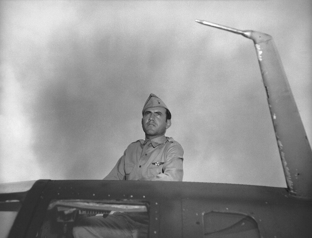 . Louis Zamperini, former USC athletic star now a bombardier in the Army Airforce, peers out of hatch nose of bomber on Jan. 1, 1943. Zamperini was bombardier of one of the planes in recent raid on Japanese-held Wake Island. (AP Photo/Jack Rice)