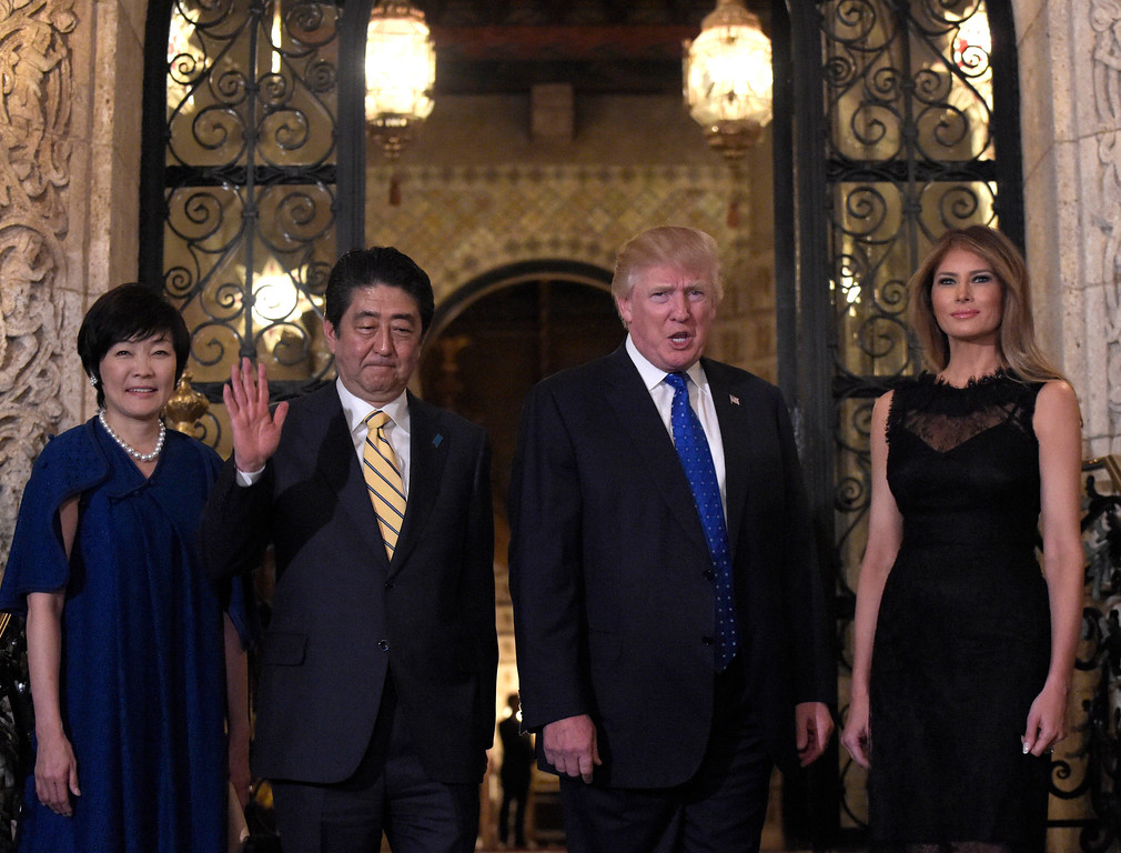 . President Donald Trump, second from right, and first lady Melania Trump, right, stop to pose for a photo with Japanese Prime Minister Shinzo Abe, second from left, and his wife Akie Abe, left, before they have dinner at Mar-a-Lago in Palm Beach, Fla., Saturday, Feb. 11, 2017. (AP Photo/Susan Walsh)