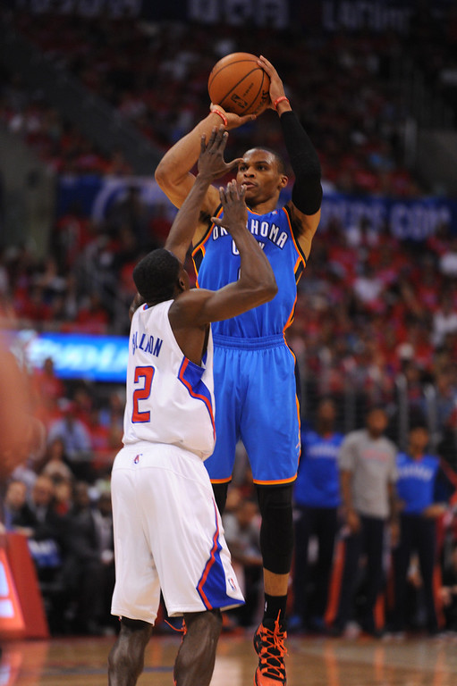 . The Thunder\'s Russell Westbrook shoots a jumper over the Clippers\' Darren Collison, Thursday, May 15, 2014, at Staples Center. (Photo by Michael Owen Baker/Los Angeles Daily News)
