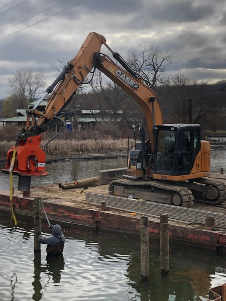NPK C6C compactor on Case - driving dock post in NY - Monroe Tractor - Mar2020.JPEG