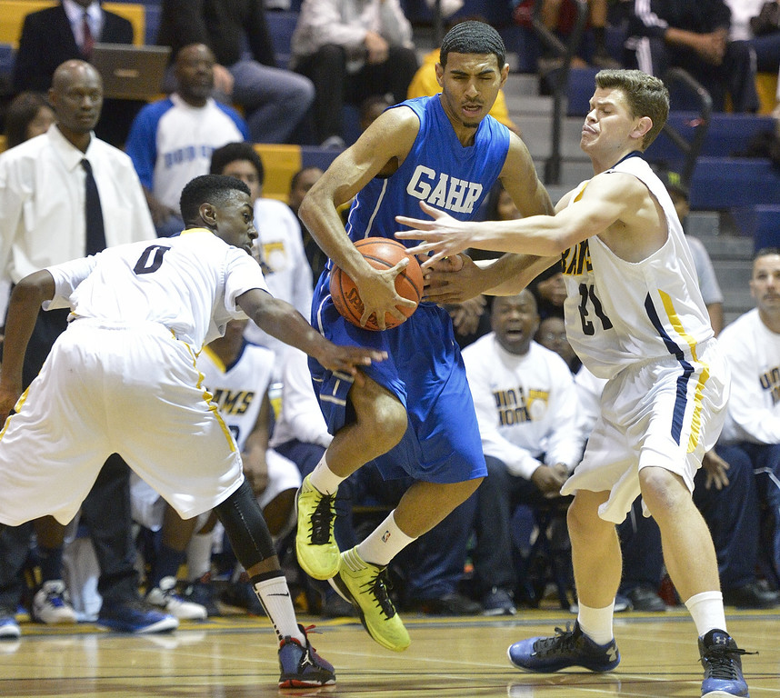 . LONG BEACH, CALIF. USA -- Millikan\'s Brian Chambers (0) an dJacob Lundi-Mallett (21) try to stop Gahr\'s Malachi Hoosein (2) during their CIF-SS Divison 1-A playoff game in Long Beach on February 15, 2013. Millikan defeated Gahr, 74 to 64. Photo by Jeff Gritchen / Los Angeles Newspaper Group
