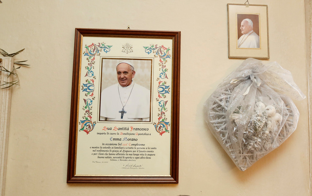 . A parchment with papal blessing is hanged on a wall of Emma Morano home,  in the day of her birthday,  in Verbania, Italy, Tuesday, Nov. 29, 2016.  At 117 years of age, Emma is now the oldest person in the world and is believed to be the last surviving person in the world who was born in the 1800s, coming into the world on Nov. 29, 1899. (AP Photo/Antonio Calanni)