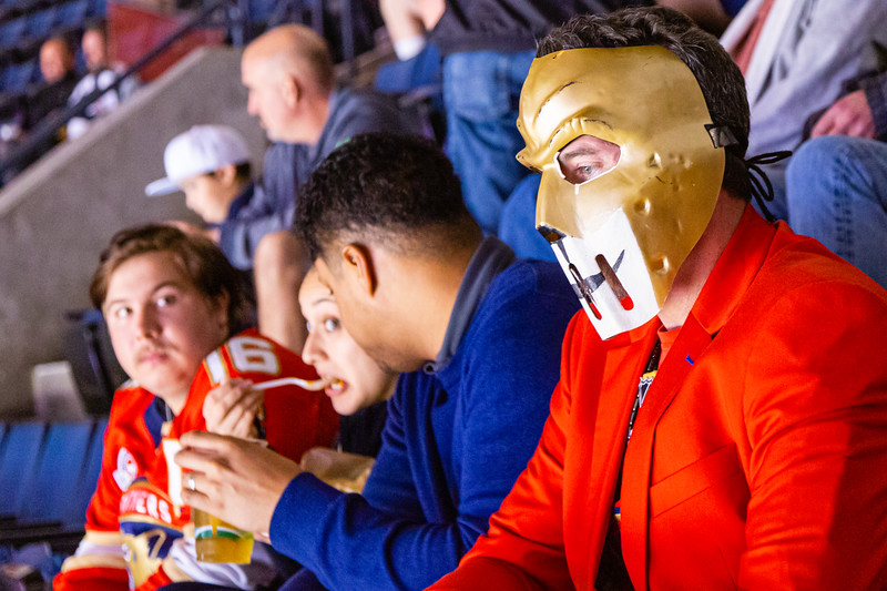 A masked Panther fan watches from the upper level as the Panthers played the Vancouver Canucks on Thursday, January 9, 2020. The Panthers would go on to beat the Canucks 5-2. [JOSEPH FORZANO/palmbeachpost.com]