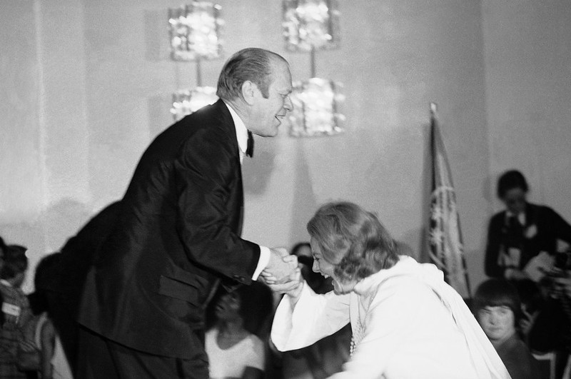 . President Gerald Ford gives television personality Barbara Walters a helping hand as she slips while stepping onto the stage in Washington, during an awards presentation March 10, 1975  for participants in the Special Olympics.    This is the international sports program for the mentally retarded at the John F. Kennedy Center for the performing Arts in Washington.  Earlier Ford attended Barbra Streisand\'s live television special at the Kennedy Center.    (AP Photo)