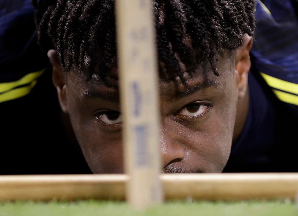 . Ohio State wide receiver Noah Brown is measured for flexibility at the NFL football scouting combine Saturday, March 4, 2017, in Indianapolis. (AP Photo/David J. Phillip)