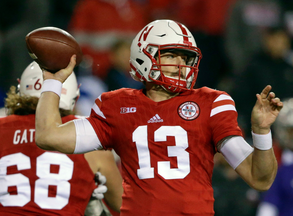 . Nebraska quarterback Tanner Lee (13) throws during the second half of an NCAA college football game against Ohio State in Lincoln, Neb., Saturday, Oct. 14, 2017. Ohio State won 56-14. (AP Photo/Nati Harnik)
