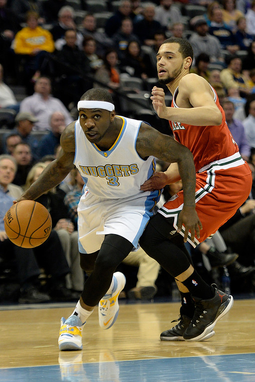 . DENVER, CO - MARCH 03: Ty Lawson (3) of the Denver Nuggets drives on Tyler Ennis (11) of the Milwaukee Bucks during the second quarter of action. The Denver Nuggets hosted the Milwaukee Bucks at the Pepsi Center on Tuesday, March 3, 2015. (Photo by AAron Ontiveroz/The Denver Post)