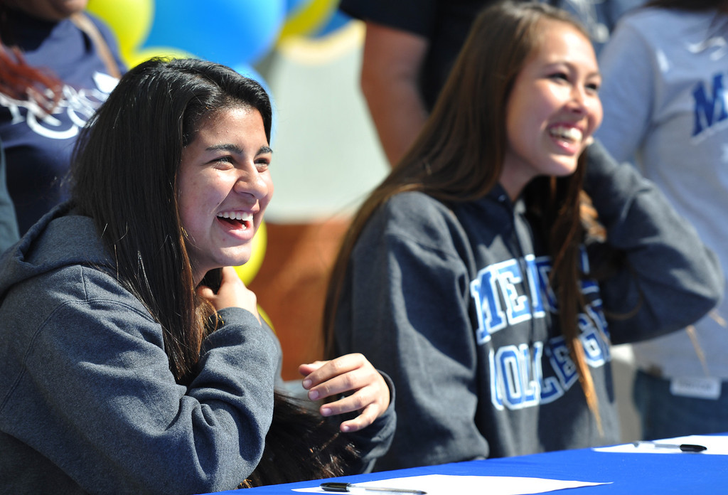 . Girls Soccer players Ileen Mejia, left, and Samantha Scovel, appear during National Signing Day at La Mirada High School on Wednesday February 5, 2014. (Staff Photo by Keith Durflinger/Whittier Daily News)