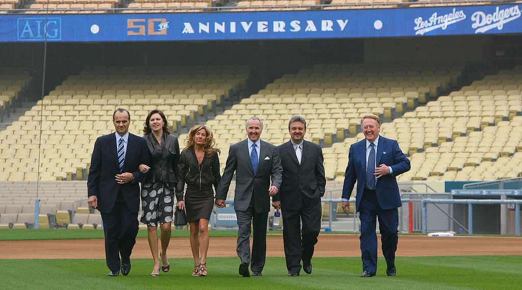 . At Dodger Stadium on November 5. 2007.  Left to Right Joe Torre his wife Ali Torre, Jaime McCourt, Frank McCourt , Dodger General Manager Ned Colletti and Broadcaster Vin Scully walk from the dugout to the platform for press conference. (Pasadena Star-News Staff Photo Keith Birmingham)