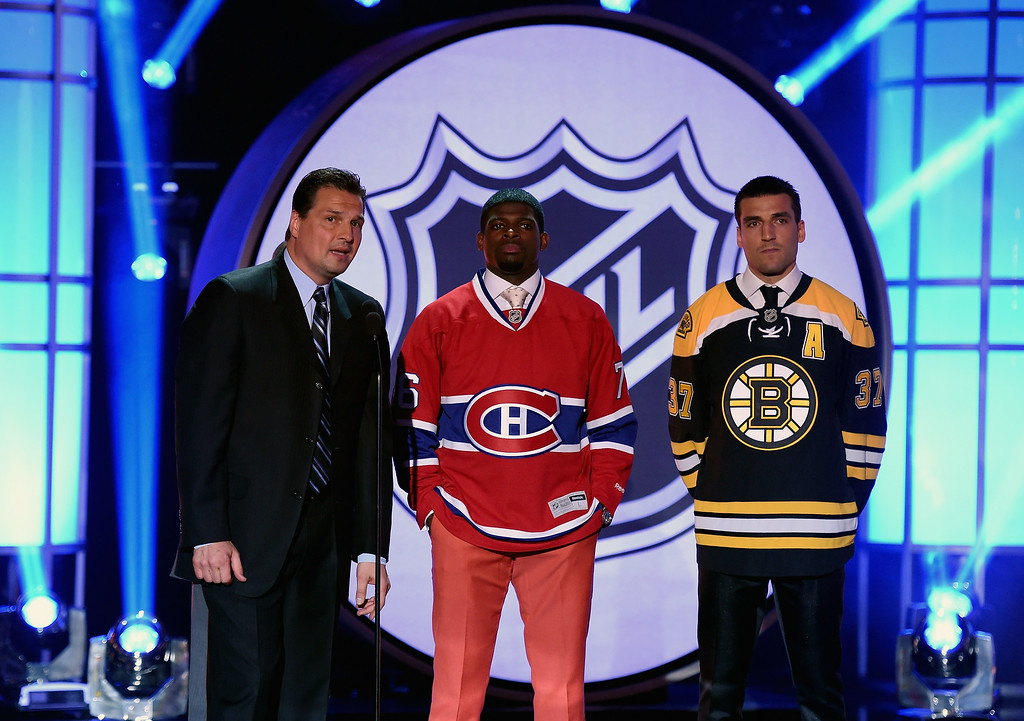 . P.K. Subban of the Montreal Canadiens and Patrice Bergeron of the Boston Bruins meet on stage with broadcaster Eddie Olczyk during the 2014 NHL Awards at the Encore Theater at Wynn Las Vegas on June 24, 2014 in Las Vegas, Nevada.  (Photo by Ethan Miller/Getty Images)