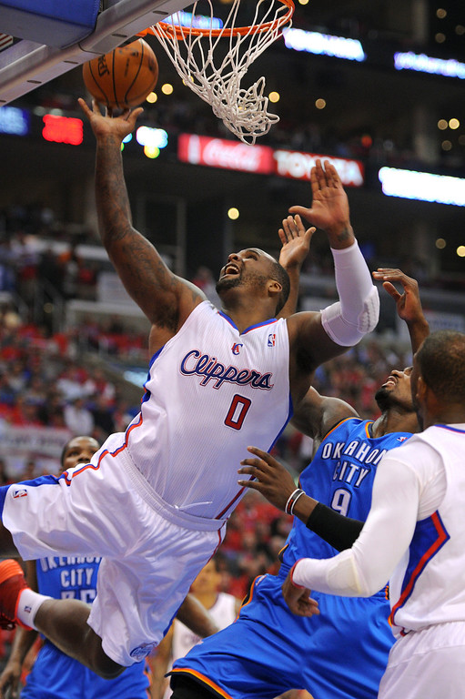 . The Clippers\' Glen Davis puts up a shot under the basket against the Thunders\' Serge Ibaka in game six of the Western Conference semifinals, Thursday, May 15, 2014, at Staples Center. (Photo by Michael Owen Baker/Los Angeles Daily News)