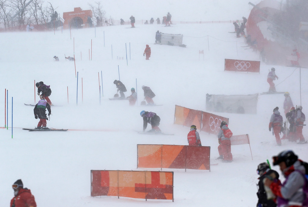 . Course crew strive to prepare the women\'s slalom course at Yongpyong alpine center at the 2018 Winter Olympics in Pyeongchang, South Korea, Wednesday, Feb. 14, 2018. (AP Photo/Luca Bruno)