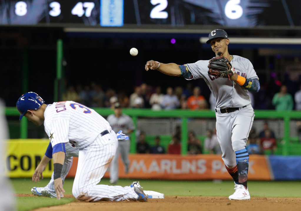 . American League\'s Cleveland Indians shortstop Francisco Lindor (12), throws for a double play as New York Mets Michael Conforto (30) is out on second, during the seventh inning at the MLB baseball All-Star Game, Tuesday, July 11, 2017, in Miami. (AP Photo/Lynne Sladky)