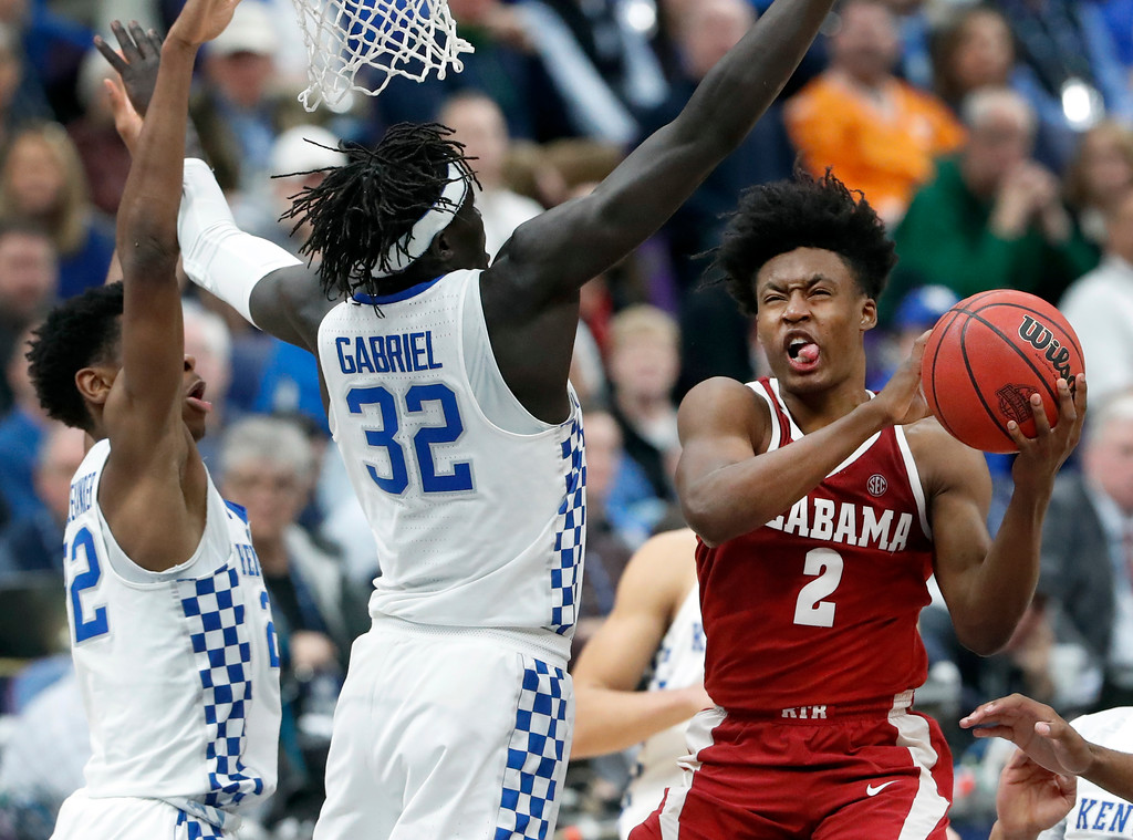 . Alabama\'s Collin Sexton (2) heads to the basket as Kentucky\'s Wenyen Gabriel (32) and Shai Gilgeous-Alexander, left, defend during the second half of an NCAA college basketball semifinal game at the Southeastern Conference tournament Saturday, March 10, 2018, in St. Louis. Kentucky won 86-63. (AP Photo/Jeff Roberson)
