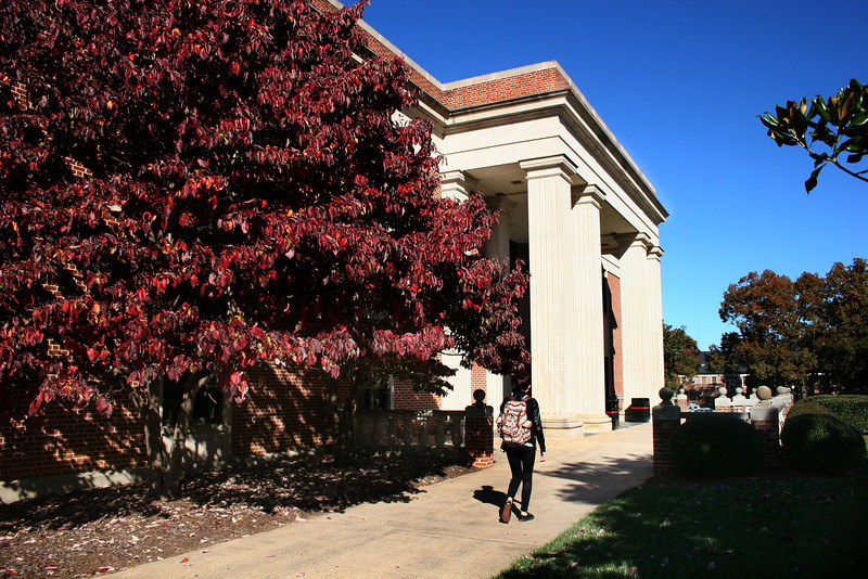 A Gardner-Webb University student walks to the Dover Memorial Library on a cool Fall day.