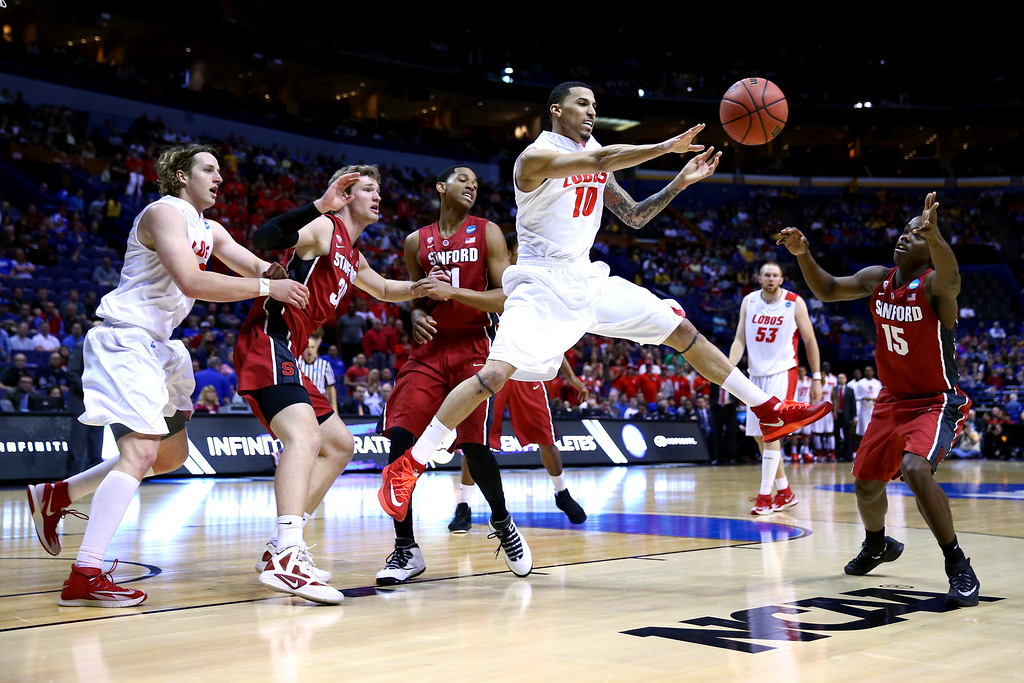 . Kendall Williams #10 of the New Mexico Lobos passes the ball against the Stanford Cardinal during the second round of the 2014 NCAA Men\'s Basketball Tournament at Scottrade Center on March 21, 2014 in St Louis, Missouri.  (Photo by Dilip Vishwanat/Getty Images)