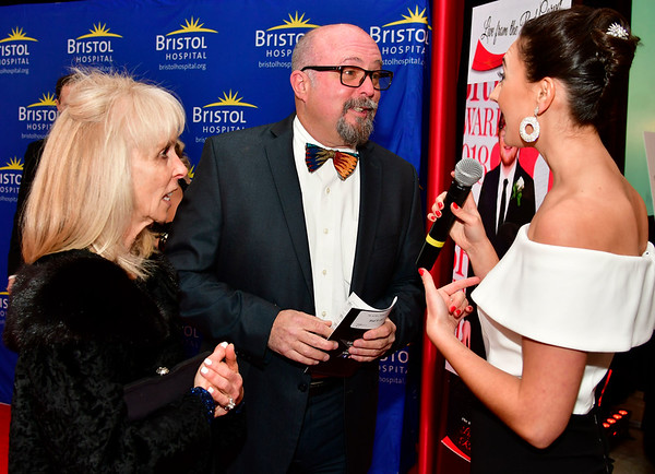 11/17/2018 Mike Orazzi | Staff Joan and Tom Roche talk with Grace Gagnon during Bristol Hospitals Annual Ball held at the Aqua Turf Club in Southington. All proceeds will benefit the Emergency Center expansion and renovation project.'