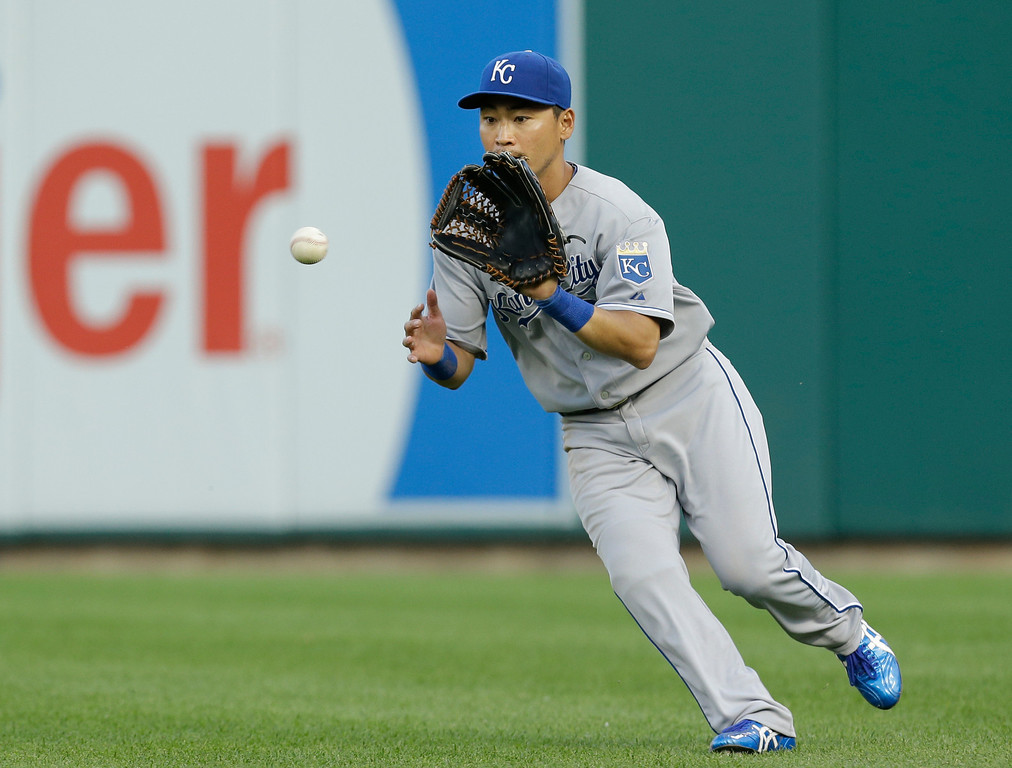 . Kansas City Royals right fielder Norichika Aoki fields a Detroit Tigers\' Torii Hunter ground ball in the fourth inning of a baseball game in Detroit, Monday, June 16, 2014.  (AP Photo/Paul Sancya)