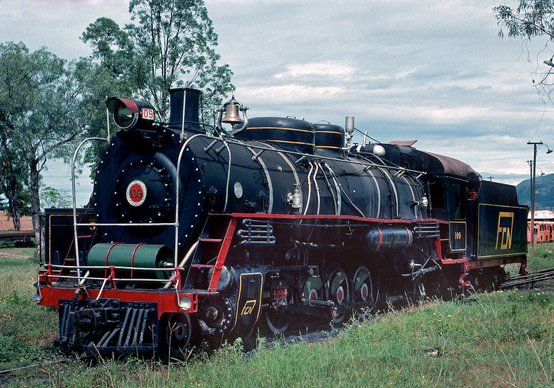 In1976 I made a quick one day visit to Giradot, Columbia, driving down and back from Bogota. The shop at Giradot was still overhauling steam engines, although the railroad was basically dieselized and steam rarely was actually used. I was told the work was some kind of French aid project, and even if the railroad didn't need the steamers they were happy to have the French pay to have the work done. There were a variety of engines at Giradot, but I thought this big 4-8-2 was especially impressive, particularly for three foot gauge. After I had returned to Bogota I was told that the road I traveled was subject to frequent attack by bandidos, and that I was lucky to have made it back with my life, money, rental car, and cameras intact. June 12, 1976.