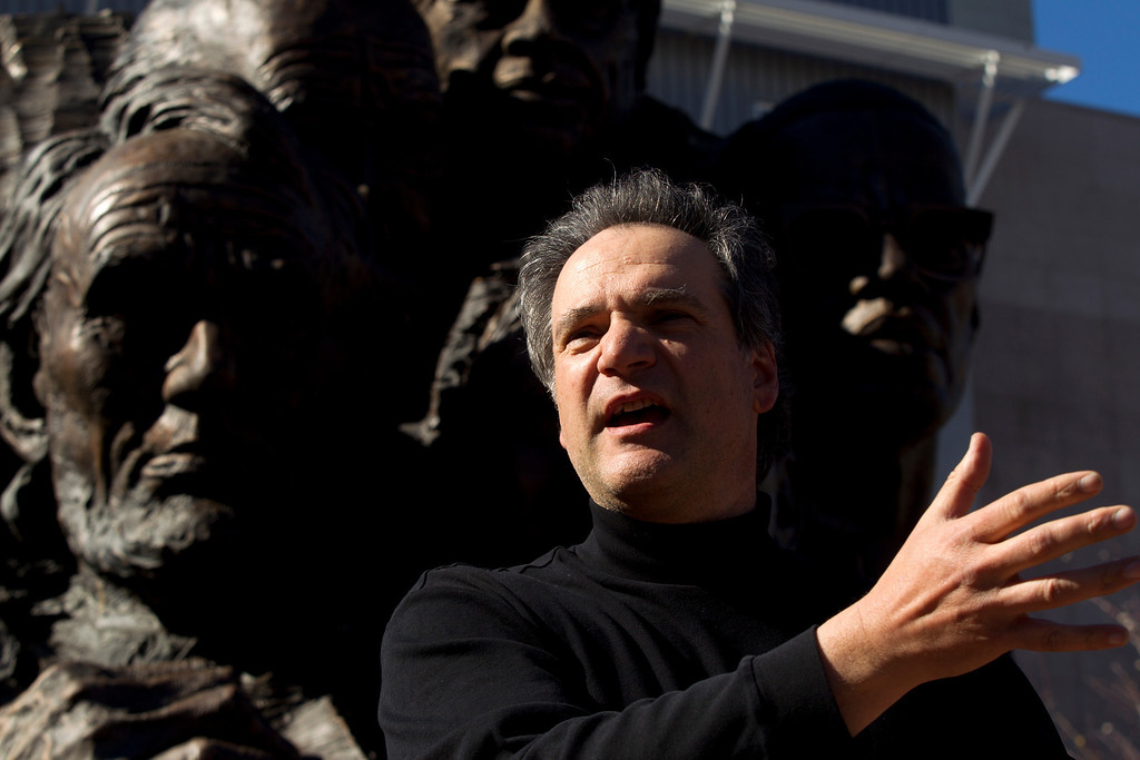 """. Mario Chiodo, the artist behind \""""Remember Them,\"""" speaks at a ceremony to dedicate the section for 9/11 first responders and firefighters in general, Thursday, Feb. 21, 2013 in Oakland Calif. (D. Ross Cameron/Staff)"""