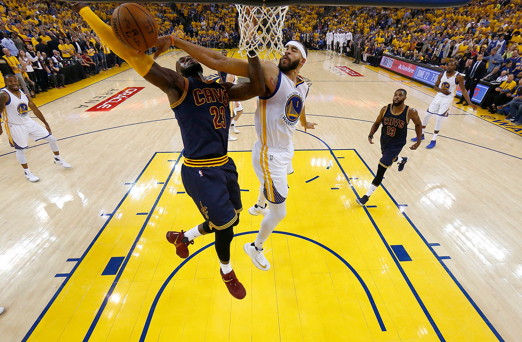 . Golden State Warriors center JaVale McGee (1) defends a shot by Cleveland Cavaliers forward LeBron James (23) during the first half of Game 1 of basketball\'s NBA Finals in Oakland, Calif., Thursday, June 1, 2017. (AP Photo/Marcio Jose Sanchez, Pool)