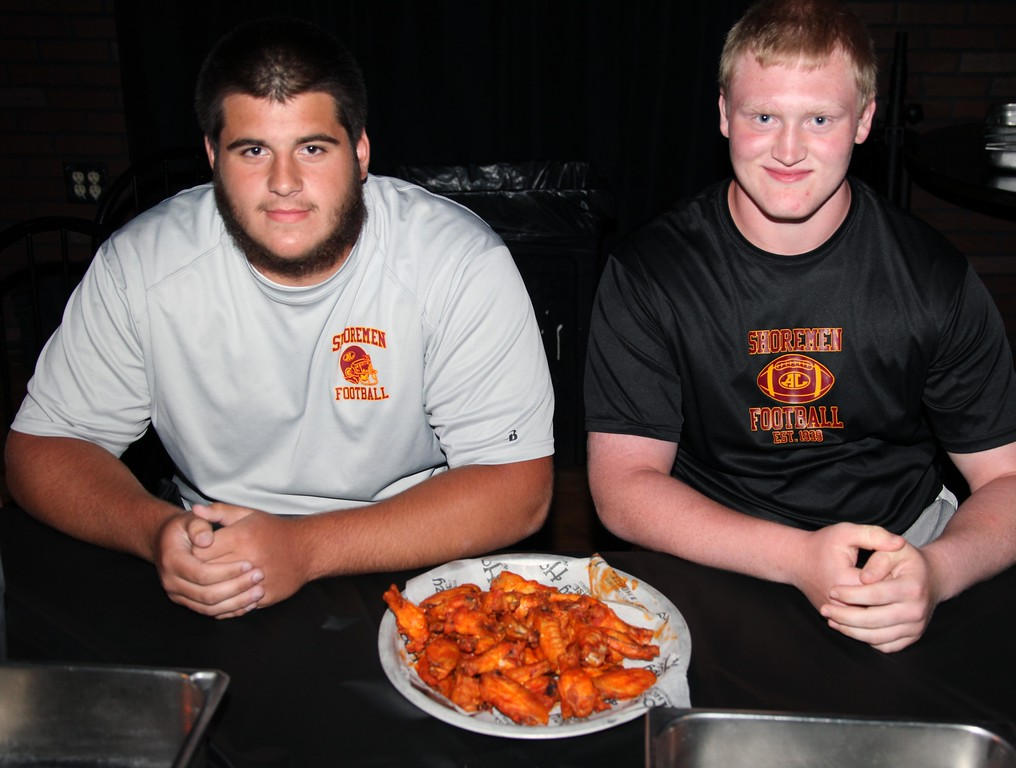 . Ryan Beckman and RJ Prusha of Avon Lake are ready to eat some wings at contest held at the Hooley House on Tuesday.
