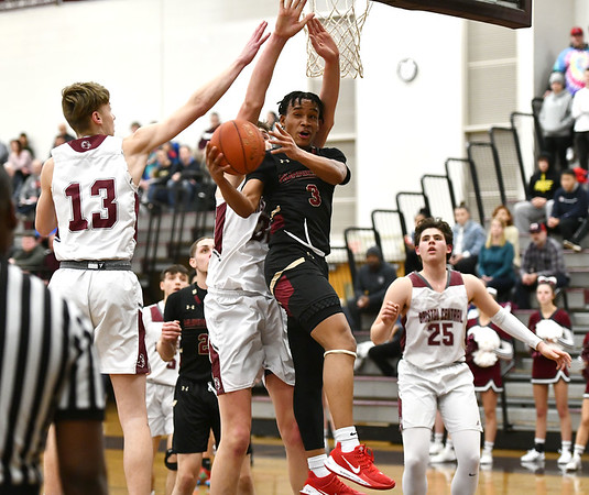 2/27/2020 Mike Orazzi | StaffrBristol Central High School's Mike Lorenzetti (13) and Donovan Clingan (32) and New Britain's Tyrone Cummings (3) during Thursday night's CCC boys basketball game in Bristol. r