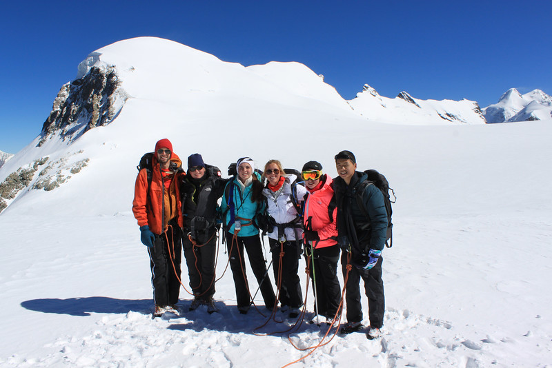 Mr. Wommack, Aidan, Ellen, Emily, Samantha, and Ryan after completing the climb with Breithorn in the background.