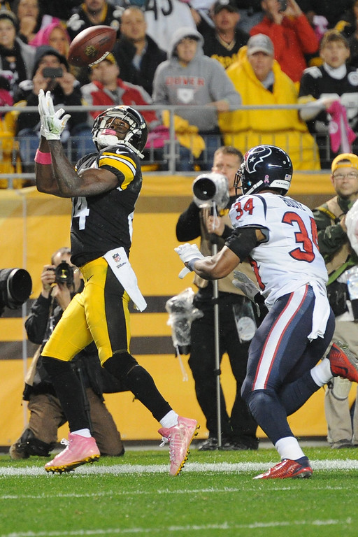 . Pittsburgh Steelers wide receiver Antonio Brown (84) tries  to make a catch past Houston Texans cornerback A.J. Bouye (34) in the fourth quarter of the NFL football game against the Pittsburgh Steelers, Monday, Oct. 20, 2014, in Pittsburgh. The catch was rued out of bounds and overturned on replay. (AP Photo/Don Wright)