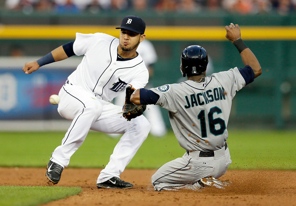 . Detroit Tigers shortstop Eugenio Suarez waits on the throw before tagging out Seattle Mariners\' Austin Jackson during a steal attempt in the fourth inning of a baseball game, Friday, Aug. 15, 2014 in Detroit. (AP Photo/Carlos Osorio)