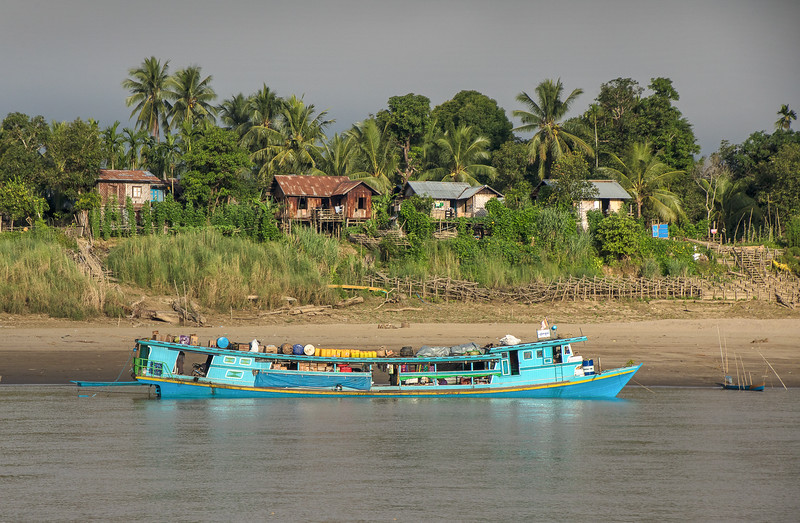 Typical boats used for transporting goods and people up and down the Chindwin River, northwestern Myanmar.