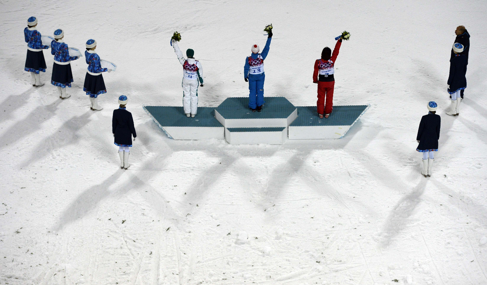 . (L-R) Bronze Medallist, Australia\'s Lydia Lassila; Gold Medallist, Belarus\' Alla Tsuper; and Silver Medallist, China\'s Xu Mengtao celebrate at the Women\'s Freestyle Skiing Aerials Flower Ceremony at the Rosa Khutor Extreme Park during the Sochi Winter Olympics on February 14, 2014. (FRANCK FIFE/AFP/Getty Images)