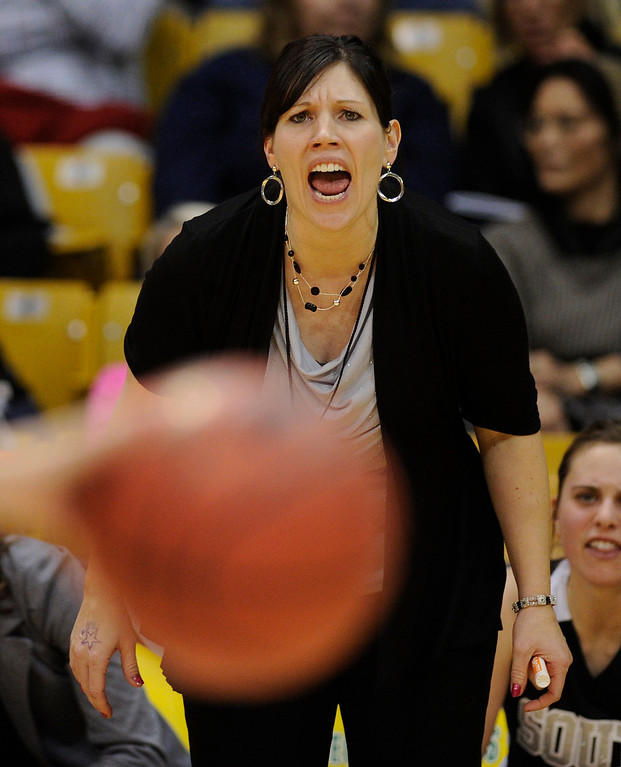 . BOULDER, CO. - MARCH 14:  Colts coach Shannan Lane yelled to her players in overtime. The Pueblo South High School girl\'s basketball team defeated Broomfield 53-50 in overtime in a 4A playoff game staged at the University of Colorado Events Center Thursday night, March 14, 2013.  (Photo By Karl Gehring/The Denver Post)