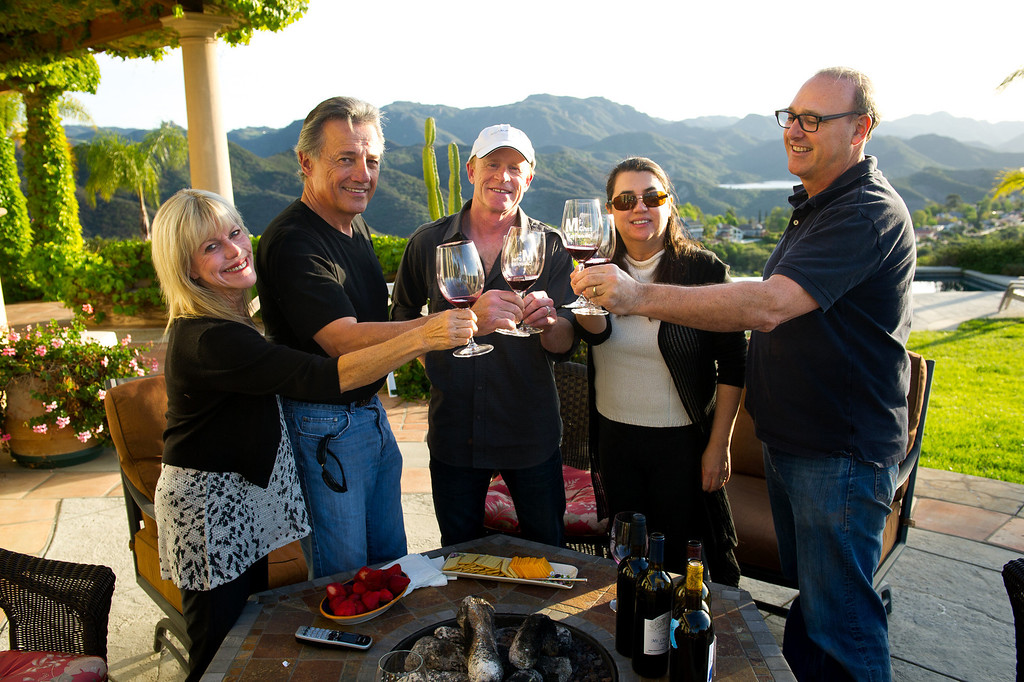 . Cellarmasters of Los Angeles members, from left, Carol Schreiber, Chet Schreiber, Andy Coradeschi, Suzy Mandel Canter and Jeff Canter toast at the Schreiber\'s Westlake home, Thursday, April 24, 2014. (Photo by Michael Owen Baker/L.A. Daily News)