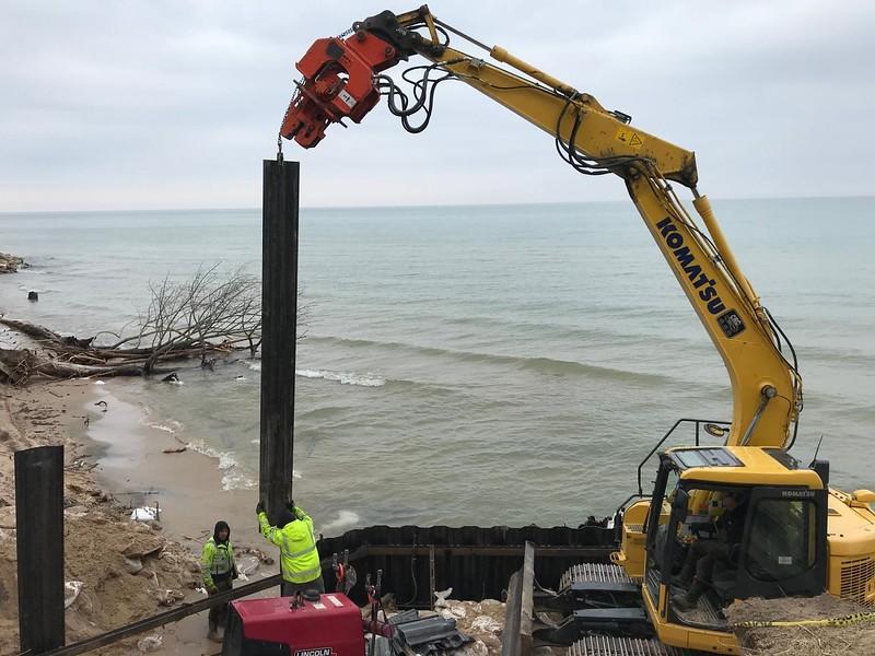 NPK C6CSD on Komatsu PC138 - Saving houses from high water beach erosion on Lake Michigan Mar2020 (2).jpg