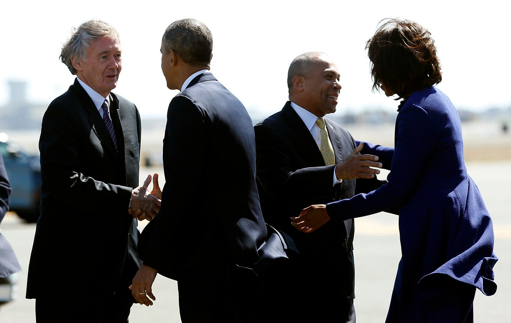 . U.S. President Barack Obama greets Rep. Ed Markey (D-MA) (L) as U.S. first lady Michelle Obama greets Massachusetts Governor Deval Patrick as they arrive at Logan Airport in Boston to attend an interfaith memorial service at the Cathedral of the Holy Cross for the victims of the Boston Marathon bombing  April 18, 2013. REUTERS/Kevin Lamarque