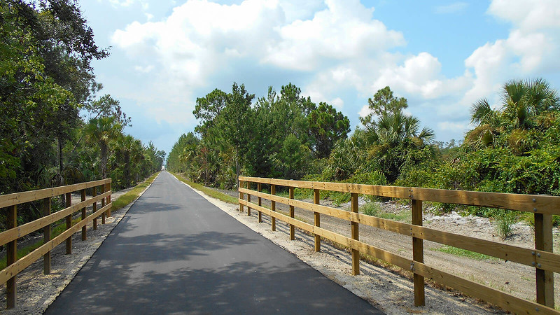 Paved trail with fences on both sides