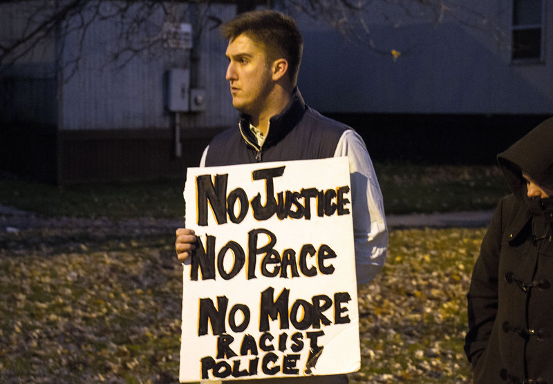 . A man displays a sign during a rally  at Cudell Commons Park in Cleveland, Ohio, November 24, 2014  where Tamir Rice, a 12-year-old boy was shot by police on November 23. Cleveland police chief Calvin Williams on Monday defended the conduct of the officer who fatally shot the 12-year-old who was wielding a replica handgun. Tamir Rice died in hospital early Sunday after two police officers, responding to a 911 emergency call, confronted the African-American youngster at a recreation center. The incident came as Americans awaited a grand jury\'s decision on whether to indict a white police officer, Darren Wilson, in the St. Louis, Missouri suburb of Ferguson for the fatal shooting in August of black teenager Michael Brown.  JORDAN GONZALEZ/AFP/Getty Images