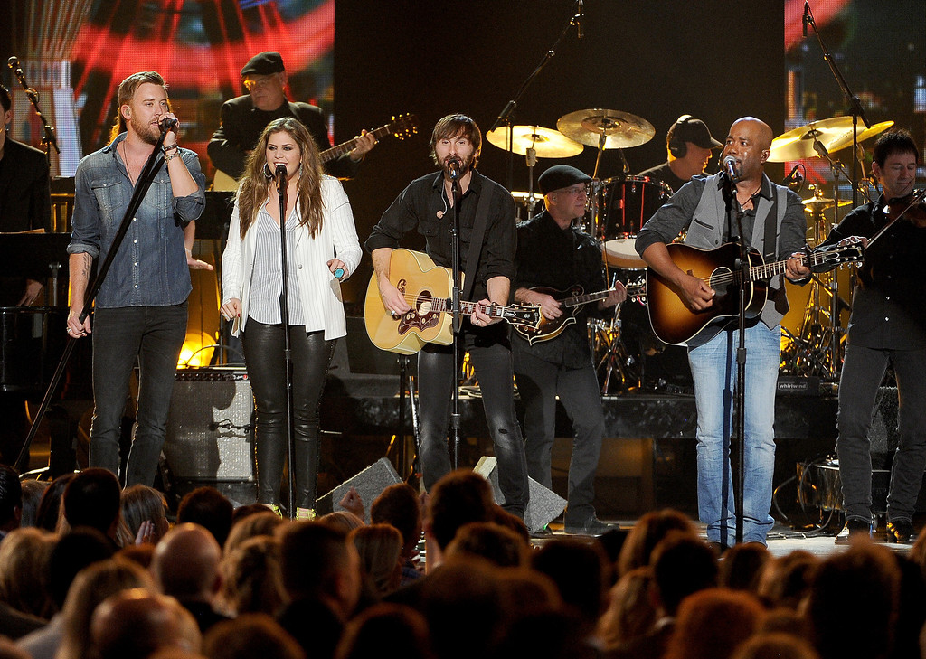 . Charles Kelley, and from left, Hillary Scott and Dave Haywood, of the musical group Lady Antebellum, and Darius Rucker perform on stage at the 49th annual Academy of Country Music Awards at the MGM Grand Garden Arena on Sunday, April 6, 2014, in Las Vegas. (Photo by Chris Pizzello/Invision/AP)