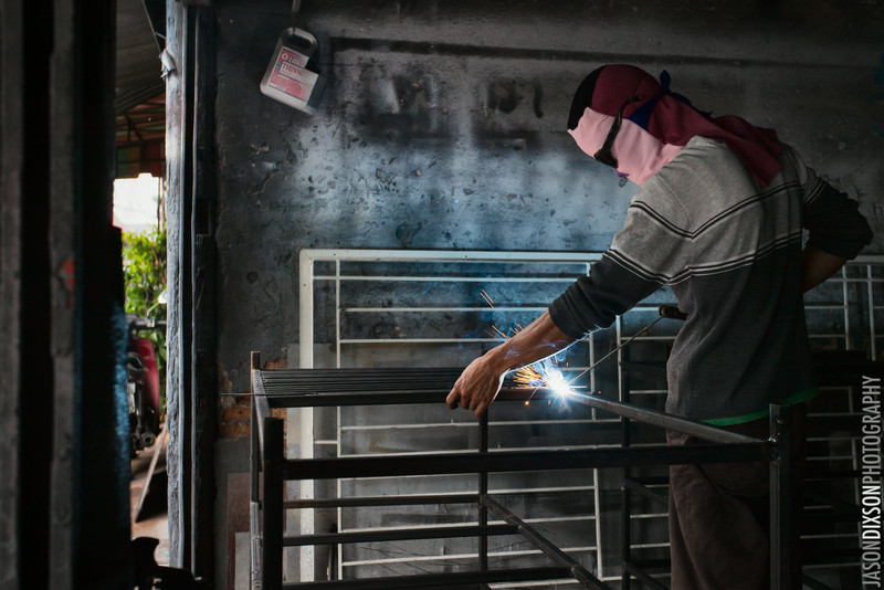 A metal worker arc welding in Chiang Mai, Thailand.