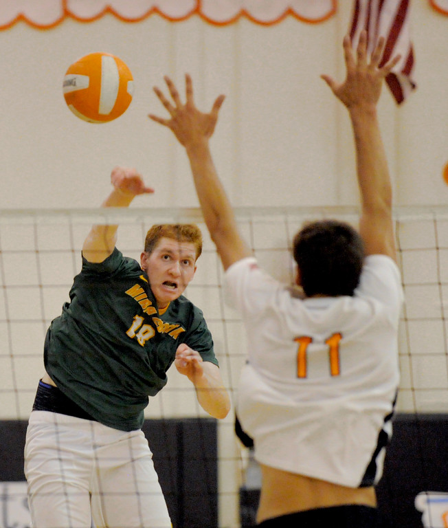 . 05-15-2013-( Daily Breeze Staff Photo by Sean Hiller) Huntington Beach swept Mira Costa in Wednesday\'s  boys volleyball CIF Southern Section Division I semifinal at Huntington Beach High School. Costa\'s Scott Stephanoff over powers HB\'s TJ Defalco.